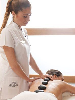 Melt away tension, ease muscle stiffness and improve circulation with a hot stone #massage #therapy at Divani Apollon Palace & Thalasso.