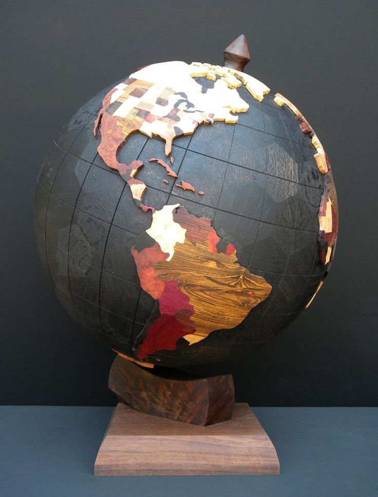 World Globe 2012 by Steve Garrison.  Thirty different hardwoods make up the states and countries.  Base sphere representing oceans is a 162-piece geodesic sphere of ebonized red oak.  18 inch diameter.