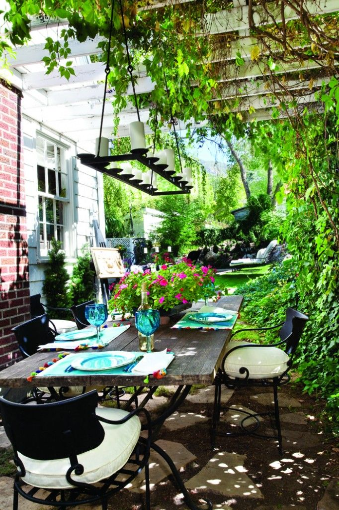 """""""The cottage windows and doors push out to the garden, blurring the boundaries between the inside and the outside.""""  #patio #dining #cottgaestyle"""