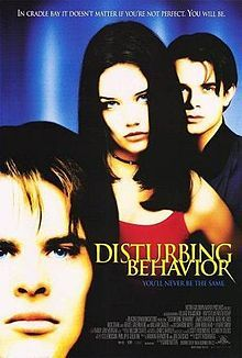 """Disturbing Behavior is a 1998 thriller science fiction film starring James Marsden, Katie Holmes, and Nick Stahl. The screenplay, written by Scott Rosenberg, follows a group of high school outcasts who are horrified by their """"Blue Ribbon"""" classmates, and was compared unfavorably by most crtitics to the 1975 thriller, The Stepford Wives. Directed by David Nutter (who was a director and producer of The X-Files as well as a director and co-executive producer of Millennium)."""
