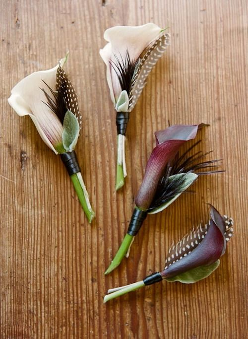 Calla Lily Boutonnieres with feathers. Classic and elegant with a twist.