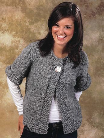 """This easy swing coat is knitted from the top down in one piece.   The only seams to weave together are at the underarm. Knit with 462 (539, 539, 616) yds of super bulky weight yarn at a gauge of 11 sts per 4"""" on U.S. size 11/8mm 16"""" and 24"""" circular needles. Sizing is oversized at 42 (46, 50, 54)""""."""