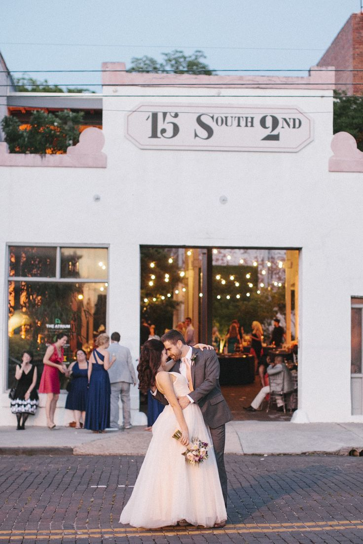 Summer wedding in downtown Wilmington, NC. Venue--The Atrium.  Gather Together Event Planning + Design. Millie Holloman Photography.