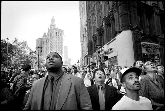 One of the most famous photographs from 911. The awe strucken faces of those witnessing history- the twin towers falling to the ground, http://www.poynter.org/latest-news/mediawire/145487/photo-editors-recall-the-images-that-moved-them-on-911/