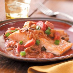 """Salmon with Gingered Rhubarb Compote Recipe -""""Rhubarb plays the role of lemon in this recipe, brightening and accenting the rich taste of the fish. I like to double the amount of compote and save half for another fast and healthy meal."""" —Susan Asanovic, Wilton, Connecticut"""