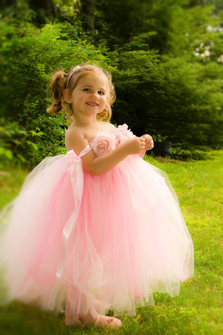 Pink flower girl dress with flower blossoms and satin ribbon ties.