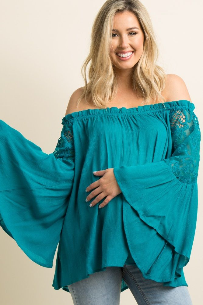 8f98b6c14bcdc A flowy solid hued maternity top featuring a cinched elastic off shoulder  neckline with a slight