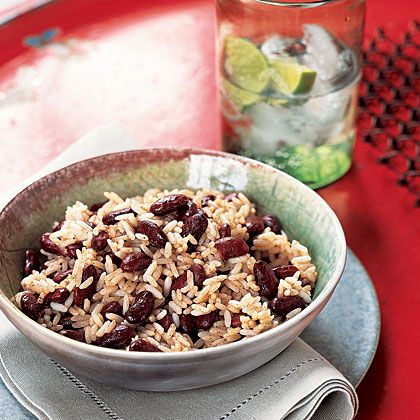 Jamaican Rice and Beans 1 (14-ounce) can light coconut milk 1/4 cup water 1/2 teaspoon ground allspice 1/2 teaspoon salt Pinch of freshly ground black pepper 3 fresh thyme sprigs 1 garlic clove, crushed 1 cup long-grain white rice (such as jasmine) 1 (15-ounce) can dark kidney beans, rinsed and drained