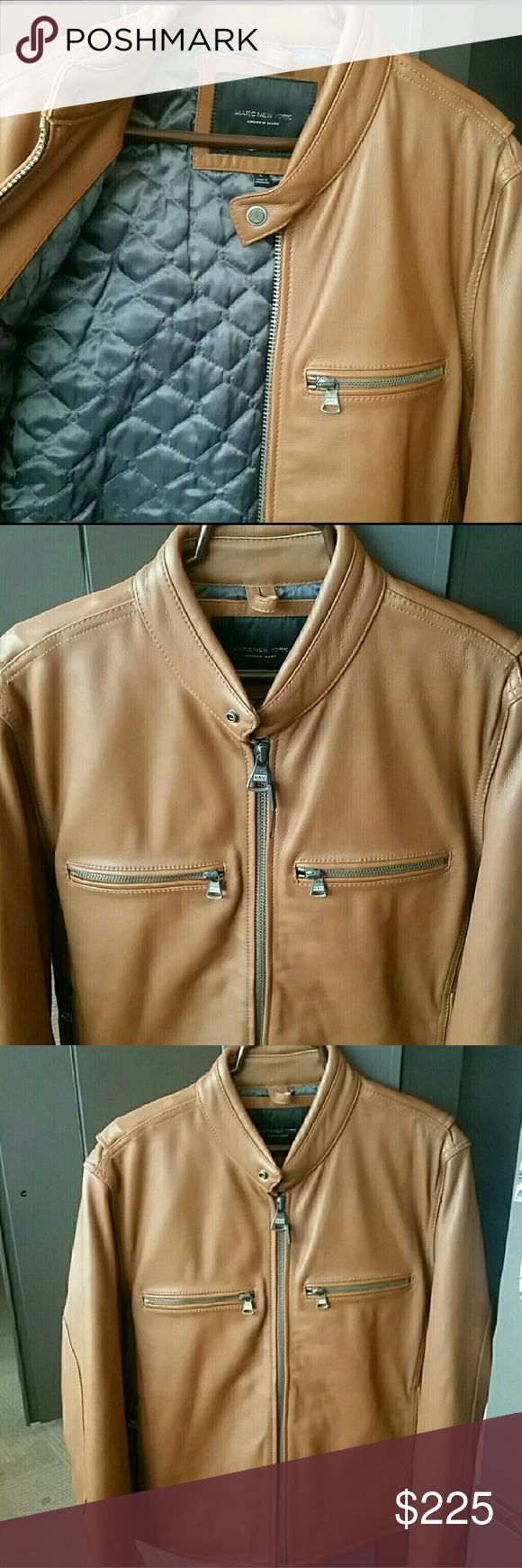 HOST PICK Andrew Marc Mens tan leather jacket HOST PICK for Men's Style Party. Andrew Marc Men's tan leather jacket, size L. Durable leather and gorgeous color. Lined with quilted material, pic 1. Beautiful details with 4 pockets and zippers, 2 on top front and 2 on sides.    Small marks/scratches in top back right, pic 7. Cosmetic flaw only, no tear/puncture. Reflected in sale price. All offers will be accepted or countered  SHELL: 100% LEATHER  BODY LINING: 52% POLYESTER, 48% VISCOSE SEEVE…