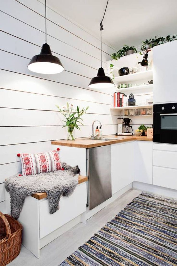 Kitchen , Bright Scandinavian Style Kitchen : Scandinavian Style Kitchen With Double Black Pendant Lighting And White Cabinets With Butcher Block Countertop And And Open Shelving And Pot Plants And Small Bench