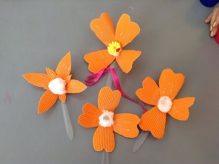 Flowers made by thick paper, cotton (in the middle) and glued on plastic spoons. Made by elderly with dementia in a health care unit.