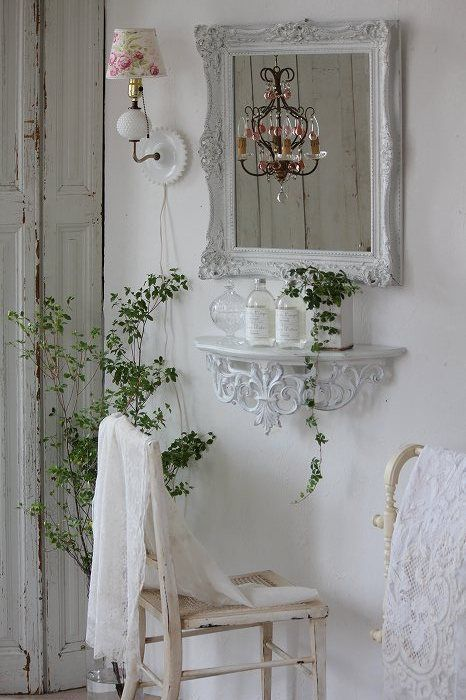using a small space for a vanity - so pretty (notice the sconce and pretty shade)