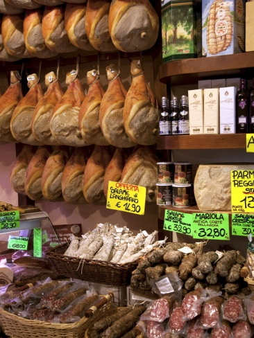 Butchers Shop, Parma, Emilia-Romagna, Italy. Parma is famous for its prosciutto, cheese, architecture, music and surrounding countryside. It is home to the University of Parma, one of the oldest universities in the world.