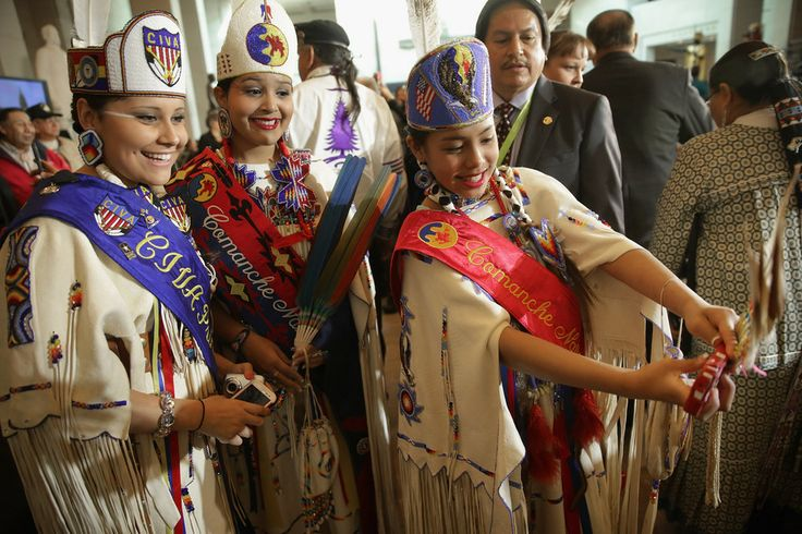 CHEESE! Young women took a 'selfie' before a Congressional Gold Medal ceremony on Wednesday in Washington. Representatives of the 33 Native ...