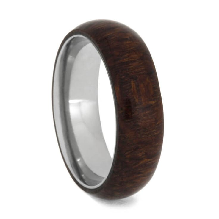 A lovely Caribbean Rosewood wedding band for someone who enjoys mother nature and outdoor activities. This titanium ring is overlaid with Caribbean