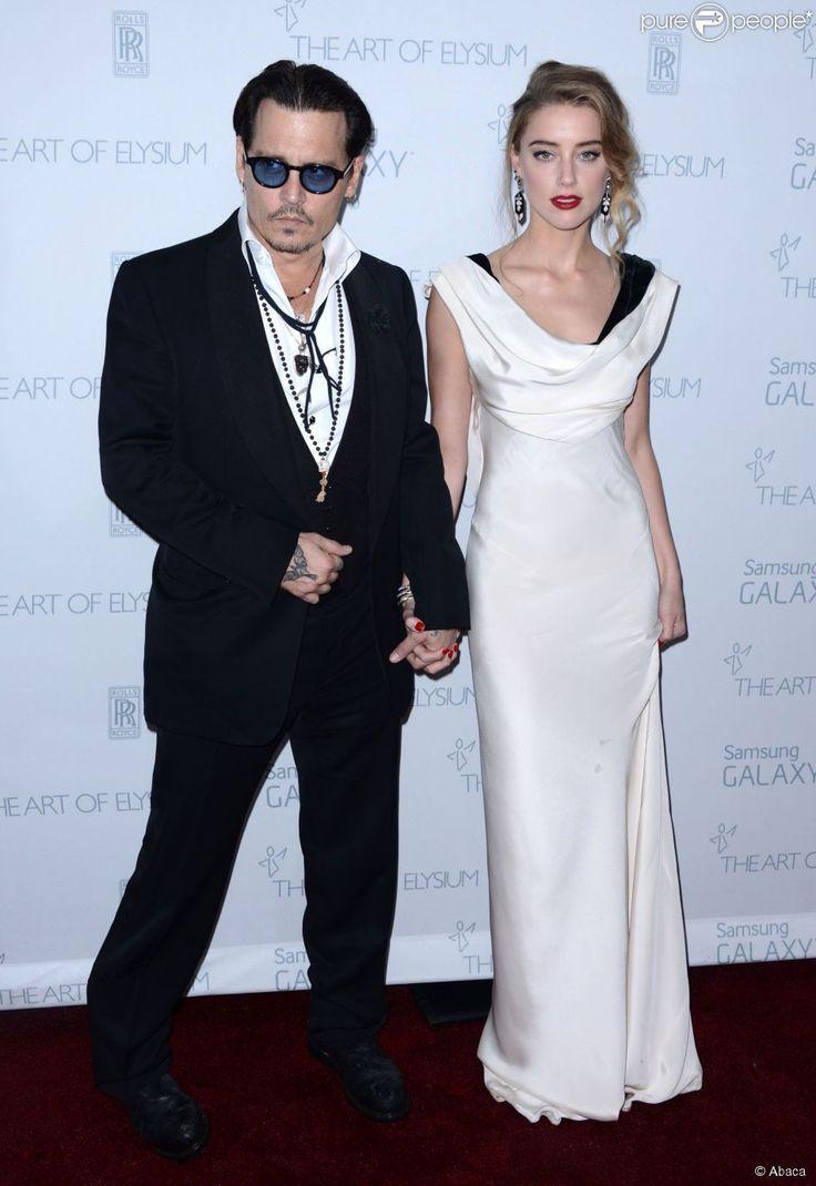 Johnny Depp et Amber Heard lors de la soirée The Art Of Elysium presents Marina Abramovic's HEAVEN au Hangar 8 à Los Angeles, le 10 janvier 2015.
