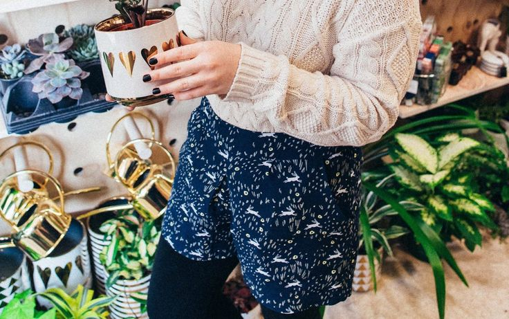 Cable knit sweater, black booties, shorts over leggings, winter style inspiration.