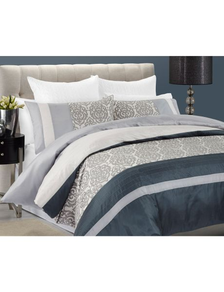 The Floyd duvet cover set by Amante features faux silk panels with an opulent jacquard in a robust colour pallet.