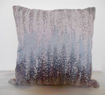 Front cover abstract forest pattern cushion Colours are a metallic light blue with silvery grey and shades of stone. forest print, woven cushions, sofa cushions, light coloured cushions, contemporary pattern cushion, grey cushions, blue cushions, silver cushions, chair cushions, soft cushions, woodland print,
