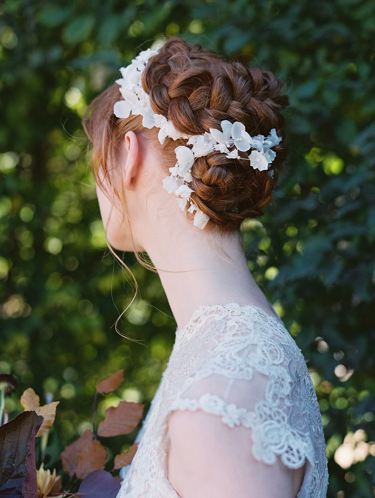 braided up do, whimsical bridal hair, little white flowers | Photography: This Modern Romance