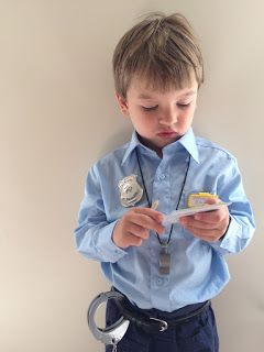 Make an easy, authentic police costume for your child with clothing from around the house and some awesome accessories! What a great DIY! Check it out.