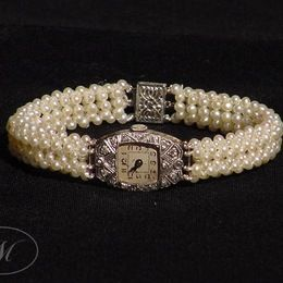 White Gold, Diamond and Pearl Watch.  Antique white gold and diamond watch (face) and white gold clasp with 3-dimensional woven seed pearl band.  By Marina J Jewelry