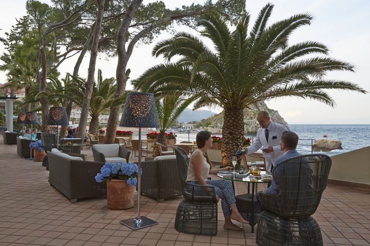 Sip a freshing cocktail at the bar by the bay