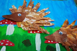 "Based on Jan Brett's book: ""Hedgies Surprise"" ...made with cut out hands of paper with oil pastel and watercolors"