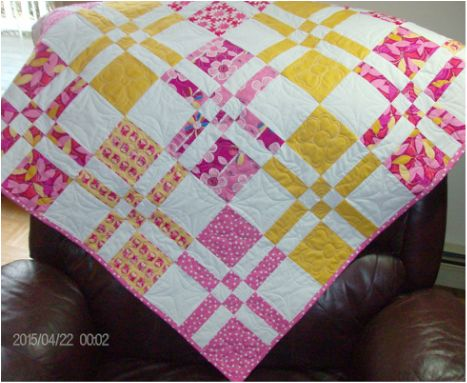 Pink and Yellow Disappearing Four Patch Baby Quilt from http://www.homesewnbycarolyn.com