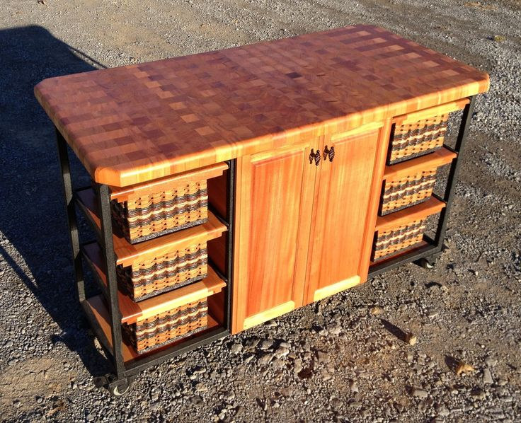 Split Six Island--30x56 end grain mahogany butcher block with casters. Behind the double doors are slide out shelves and the 6 small basket drawers make it easy to organize. If you need it in another room or outside to serve on then simply roll it to where you want it! Design yours today!