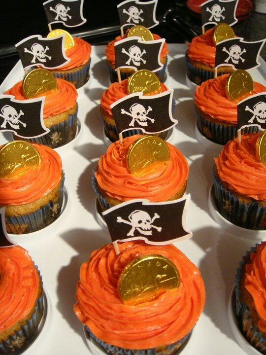 Pirate Cupcakes....pink icing to match the theme..love the coin idea!