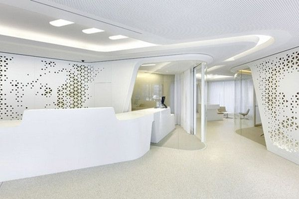 The Reception Desk With Perforated White Walls Modern Bank Interior Design