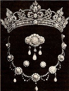The Rundell Tiara - Queen Victoria's son, the Prince of Wales (known in the family as Bertie), married Princess Alexandra of Denmark in 1863. The future King Edward VII gave his wife an impressive start to her jewel collection: a parure of a diamond tiara with a pearl and diamond necklace, brooch, and earrings.