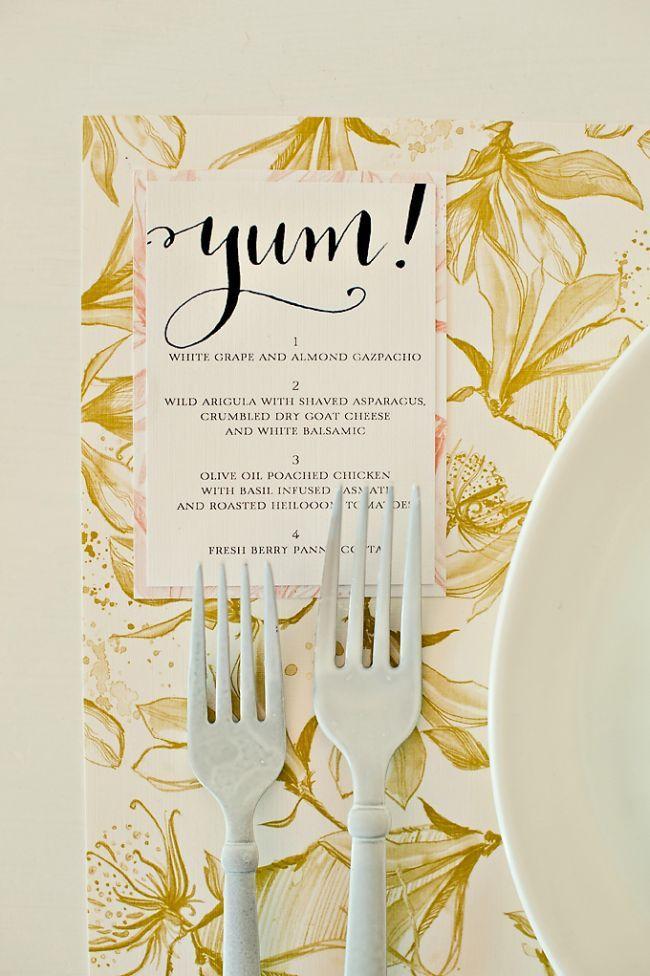menu tucked under plate, top left corner, darling