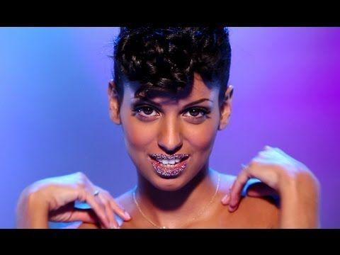 Tal-- her new song 'rien n'est parfait' is good for practicing la négation