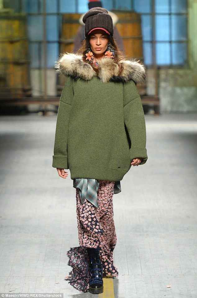 Catwalk queen: Joan Smalls stepped out in an eclectic green sweater and floral floor lengt...