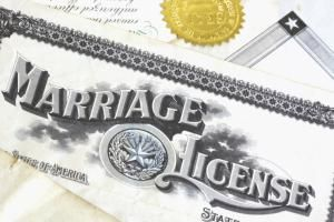 Marriage licenses, certificates and other marriage records are a valuable source for locating maiden names. - Kathryn8 / Getty
