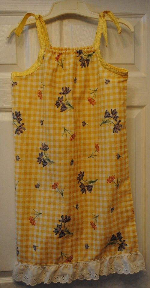 Pillowcase dress tutorial. Easy! And I like the look of this one with the bias tape more than some others I've seen.