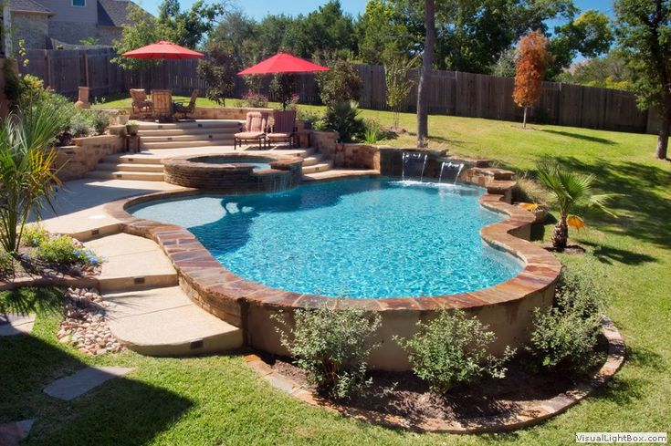 Like the stone surround built on slope pool ideas for Pool design sloped yard