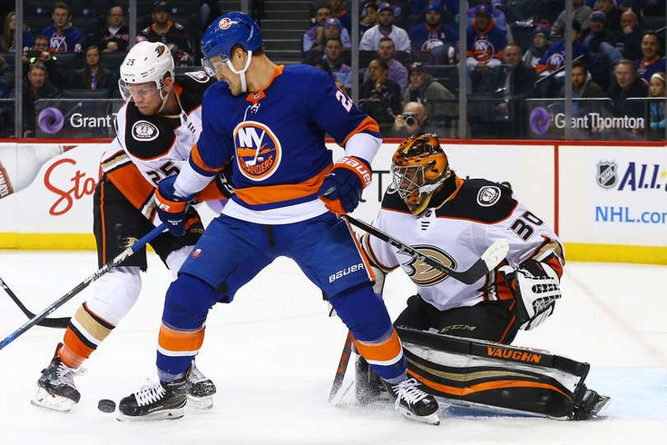 nders Lee #27 of the New York Islanders tries to gain control of the puck as Ondrej Kase #25 and Ryan Miller #30 of the Anaheim Ducks defend the net during the first period at Barclays Center on December 21, 2017
