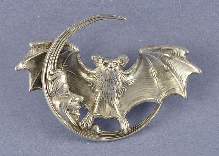Circa 1900, Bat in Flight with the Man in the moon brooch. Made by Unger Brothers, USA.