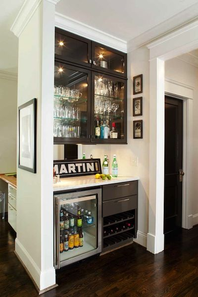 Custom Bar Design With Built In Mini Refrigerator And Mirrored Backing.  Would Be Great In