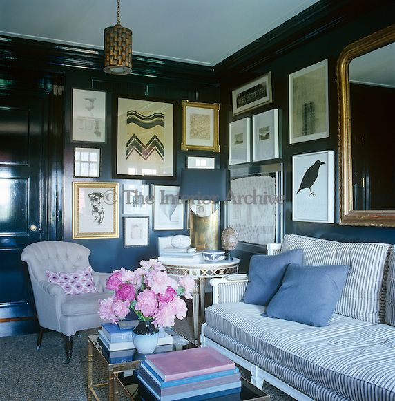The Wooden Panelling Of A Snug Informal Living Room Is
