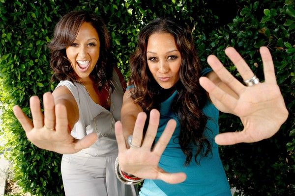 """Today's mixed chicks of distinction are Tia and Tamera Mowry. Born in Germany and raised in Southern California, the twins are the product of an African-American mom of Bahamian heritage and their dad is of British ancestry. They made their foray into the world of entertainment on the hit show """"Sister Sister"""" and have never looked back. The twins literally grew up before our eyes."""