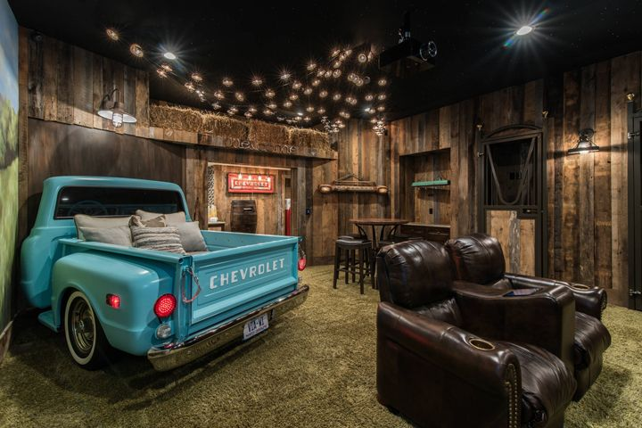 """drive-in"" home theater with turquoise pickup truck"
