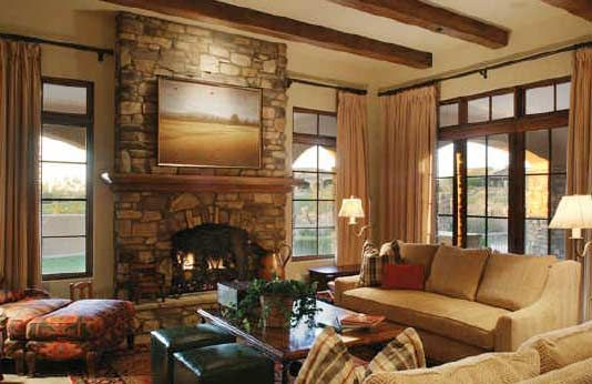 cottage style living room with stone fireplace living