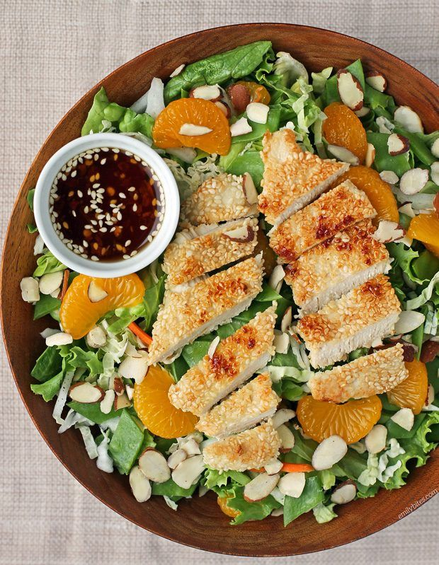 This Asian Sesame Chicken Salad features sesame-crusted chicken and a tangy sesame dressing for just 321 calories or 7 Weight Watchers SmartPoints! www.emilybites.com