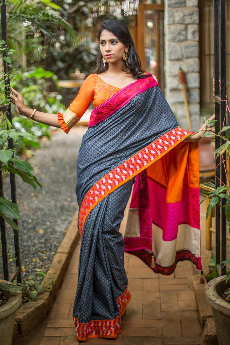 This tri-colored saree is multifaceted - she is bold, she is sophisticated, she is effortless. With a rich pink border on one side and printed orange-white border on the other side, these standout against the deep blue body of the saree. Equal parts colorful and subtle, she works her way for any type of event - festivities, office meeting, brunch. An orange blouse pairing could amp up the look. ACCOMPANIMENTS:All sarees are sold completely finished with falls (where required) and a free…