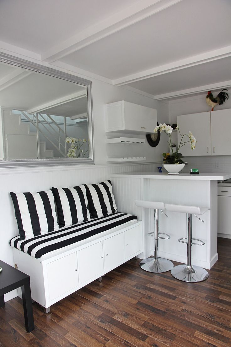 Tiny House Furnishings:  Make your seating pull double duty as storage.  A big chest as a coffee table could work too.