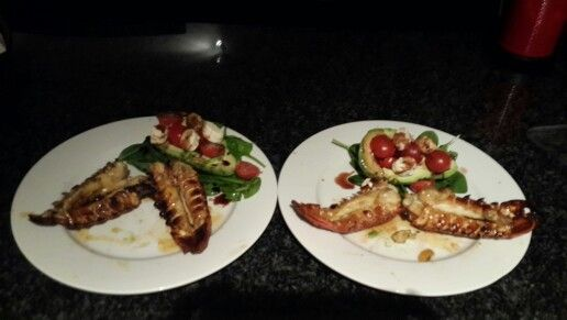 Home made lobster with tangerine and garlic butter souce, with avo cheese and italian vine tomatoes with a drizzle of balsamic vinegar.